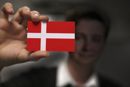 Businessman is holding a business card, flag of Denmark