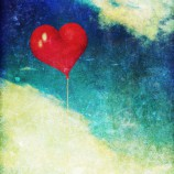 Vintage photo of red heart balloon in the sky